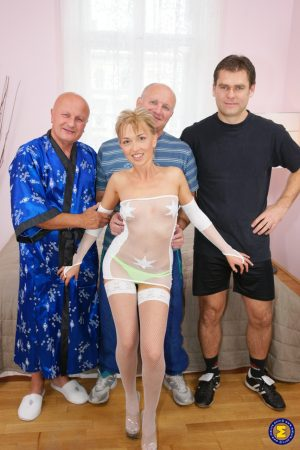 Skinny mature Margrit gets rammed hard by three kinky old men on a bed