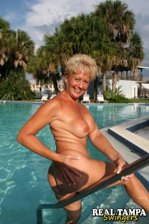 Stunning mature wife Tracy Lick naked at the pool spreading ass in the sun