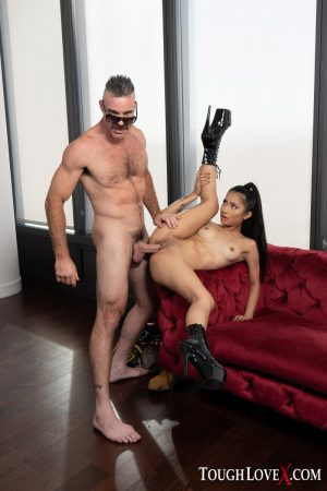 Cute Asian girl Avery Black gets banged while wearing stiletto boots