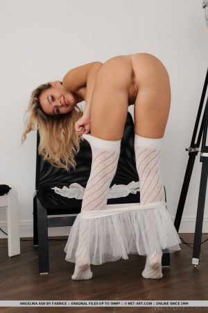 Cute blonde teen Angelina Ash doffs a tutu and fishnets to show her nice pussy