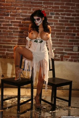 Alexis Amore shows magnificent big tits in solo action at a Halloween party