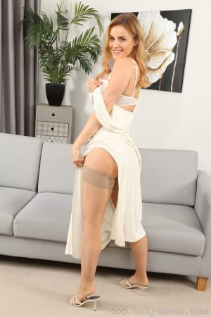 Hot wife Amy Green removes her dress and teases with her huge bosoms in nylons