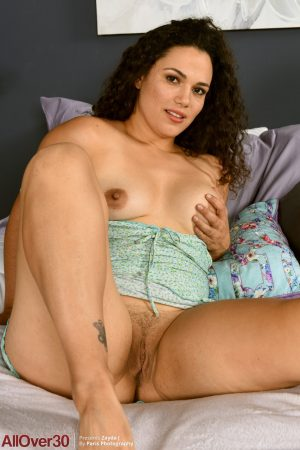 Chubby amateur MILF Zayda J strips on the bed and touches herself