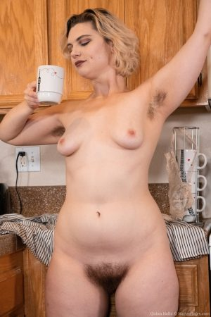Chubby amateur Quinn Helix displays her hairy pits and bush while in a kitchen