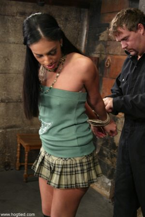 Dark haired girl Ice La Fox gets tied up with panties around ankles of boots