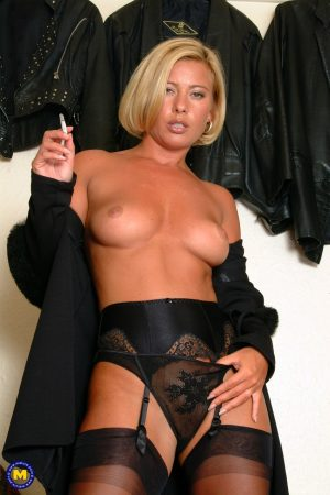 Blonde cougar in lingerie Tracey Coleman smokes and flashes her lovely breasts