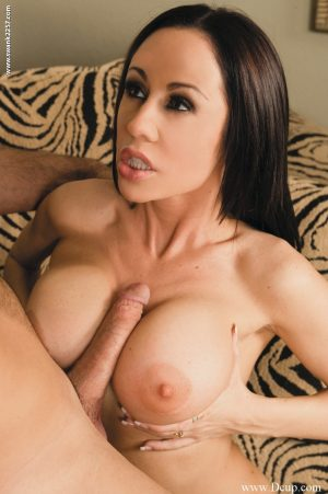 Brunette MILF with huge fakes Davia Ardell rides a stiff dick on a couch