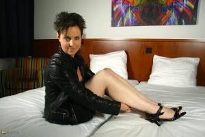 Older Dutch housewife tales off a leather jacket before toying her vagina