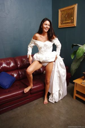 Graceful brunette babe Nikki Daniels slipping off her dress and panties