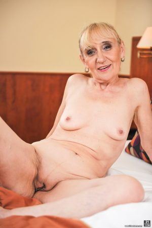 Smiley granny Nanney shows her mature pussy as she removes her lace lingerie