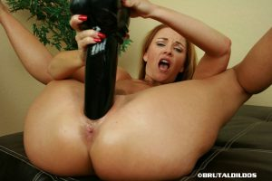 Busty mature redhead Janet works a big black dildo up her hairy muff