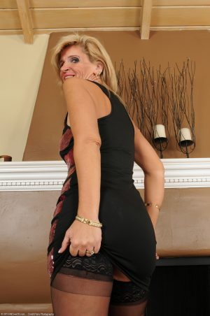Old blonde Crystal Jewels showing her tiny tits & her MILF pussy in stockings