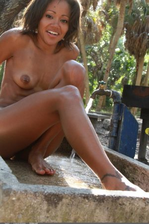 Absolutely naked black chick Isabella B fools around in fresh air