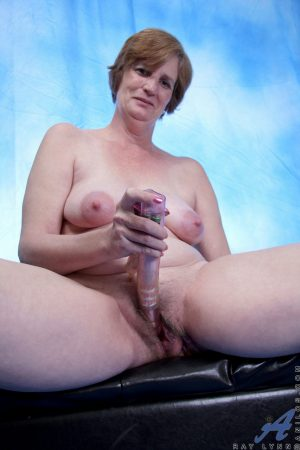 Mature MILF Ray Lynn undresses before shoving a toy in her mature cunt