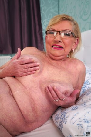 Sassy mature granny Irene offers up saggy big tits & hairy pussy on her bed