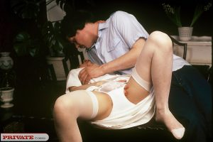 Classic pornstar from the early 70s gets fucked in white stockings and garters