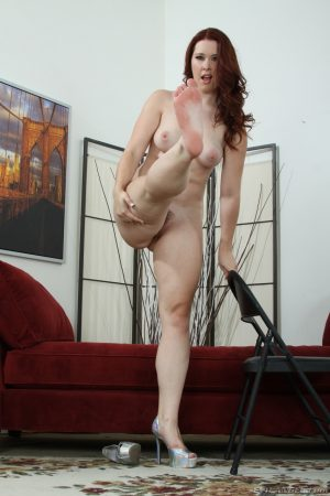 Redhead MILF Melody Jordan reveals her natural tits & big round ass in a solo