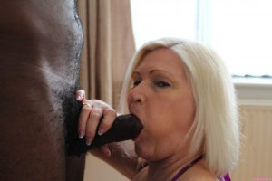 Blonde GILF with big tits Lacey Starr tastes and fucks a black dong