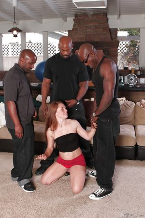 Sexy redhead chick Scarlett Wild is banging in a hot interracial scene