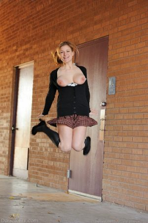 Amateur abbe letting big natural schoolgirl tits loose outdoors in socks
