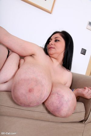 Fatty Alice 85JJ strips naked to show her XXL natural tits & her bald cunt