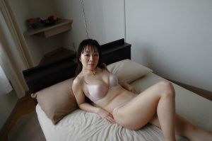 Playful japanese MILF slowly gets rid of her clothes and lingerie