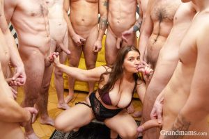 Sexy mom with big juggs Yvette gets fucked by many young guys wearing lingerie