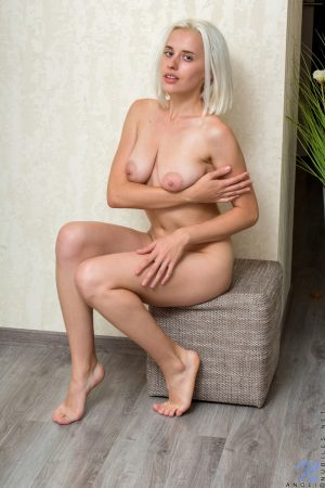 Blonde college girl Anoli uncovers sagging boobs before parting her pink pussy