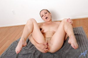 Flexible mature Claudia Adkins parting her sexy legs to expose shaved pussy