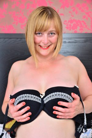 Lovely mature woman April revealing her sexy curves and touching herself