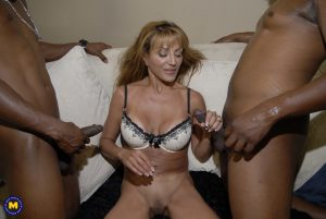 Mature mom Sophia C feeds two black cocks to her horny twat in a hot threesome