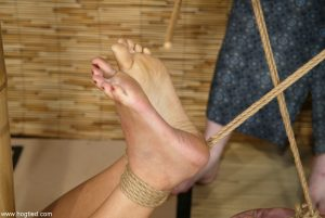 Brunette Asian babe Mikayla gets tied up and abused by a blonde domme