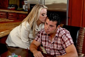 Horny blonde chick Carolyn Reese practices her seduction skills on her man