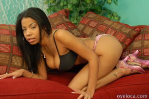 Busty ebony babe Havana Ginger shows off her stunning body on the couch