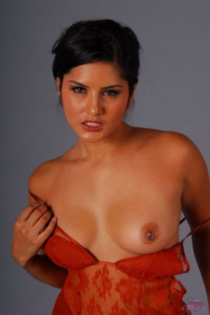 Sexy Indian pornstar Sunny Leone sheds sheer lingerie baring pierced nipples