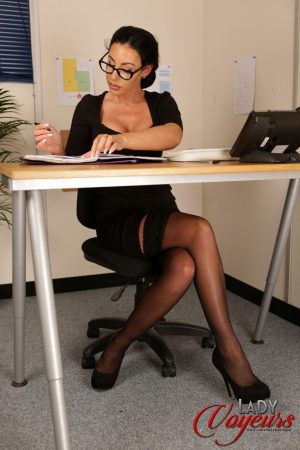 Secretary Mila Amora shows off her pink panties & touches them while working