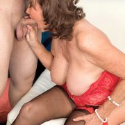 Sexy nan Jacqueline Jolie gets fucked by her younger man friend in stcockings