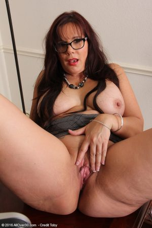 Hot chubby mature Sasha Karr in glasses rubbing her horny cilt at her desk