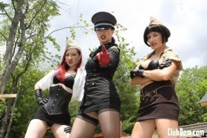 Kinky Tatiana and two other dommes abuse a submissive guy outdoors