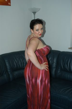 Filthy German MILF Pam hikes her red dress up and masturbates with a vibrator