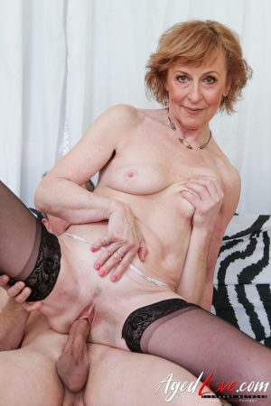 Elegant granny gets her mature pussy pumped by her younger lover's dick