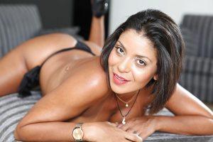 Latina brunette Ana Luz shows off her mature ass in bikini
