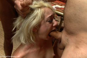 Blonde nympho Moretta kneels and enjoys a blowbang with horny guys