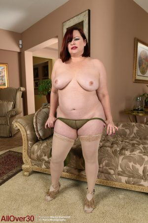 Chubby redhead wife Marcy Diamond exposes her fat ass and masturbates