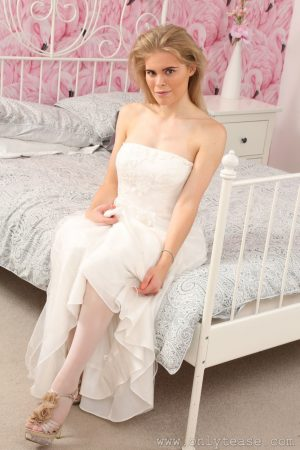 Sexy chick Tayla doffs wedding dress & poses in white lingerie in her bedroom
