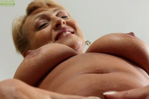 Older blonde fatty Andrea strips and masturbates freshly shaved cunt