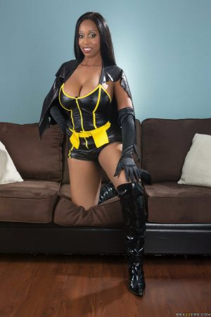 Ebony MILF Codi Bryant strips out of her sexy costume to flaunt her big tits
