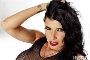 Latina babe Romi Rain shows off her awesome tattoo and boobies