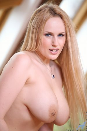 Czech blonde with huge natural tits sticks the devil's tongue into her pussy