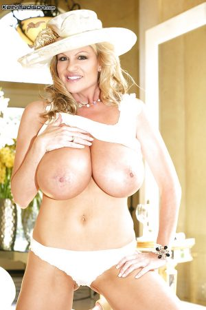 Kelly Madison demonstrates her big tits in a white wedding dress